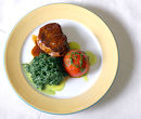 Beef steak with roasted tomato and spinach puree