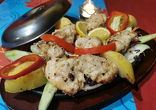 MALAI KEBAB chicken fillet marinated in cream, roasted in tandoor garnished with vegetables