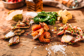 MARINE TAPAS SET - marinated sardines with vegetables, marinated octopus, marinated shrimps аrtichokes, Padron peppers with Maldon salt, bruschettas with smoked spicy olive oil