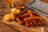 PROK RIBS - with bbq glazed salsa, served with colored bean with pickled cucumbers, roasted corn, baked potatoes with herbs butter and BBQ sauce